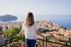 In City of Dubrovnik. Woman looking at Dubrovnik old town royalty free stock image