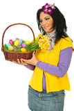 Woman looking at Easter basket Royalty Free Stock Photography