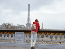 Woman looking on the Eiffel Tower in Paris, France Stock Images