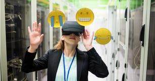 Woman looking at emojis through VR glasses Royalty Free Stock Photo