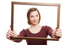 Woman looking through empty frame Royalty Free Stock Photo