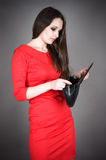 Woman looking at an empty purse Royalty Free Stock Photo