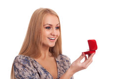 Woman looking at engagement ring in a box Stock Photos