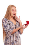 Woman looking at engagement ring in a box Stock Photography