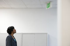 Woman looking at exit sign Stock Photo