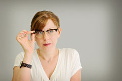 Woman looking through eye glasses Royalty Free Stock Photo
