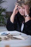 Woman looking at family souvenirs royalty free stock photos
