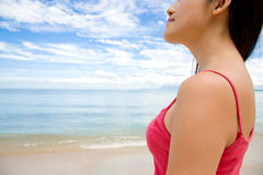 Woman looking far ahead by the beach royalty free stock image