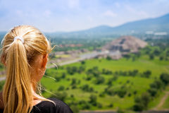 Woman looking far away Stock Images