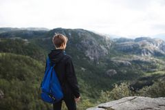 Woman Looking Far Away in Norway. Woman looking far away on top of mountain in Norway Royalty Free Stock Images