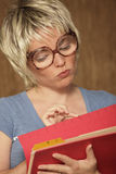 Woman looking through files. Image of a secretary looking through files Stock Image
