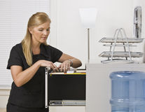 Woman Looking Through Filing Cabinet Stock Photo
