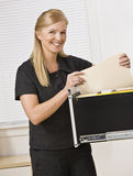 Woman Looking Through Filing Cabinet Royalty Free Stock Photography