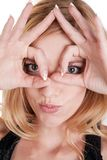 Woman looking through fingers circles Royalty Free Stock Photo