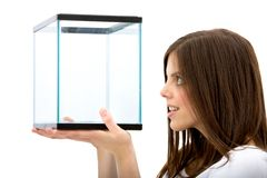 Woman looking at a fish tank Stock Photo