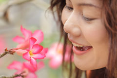 Woman looking flower Royalty Free Stock Image