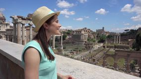 Woman looking at Forum Romanum. Female tourist enjoying vacation near Roman forum in center of Rome stock footage