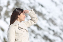 Woman looking forward with the hand on forehead in winter Stock Photography
