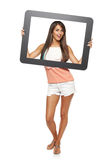 Woman looking through frame Royalty Free Stock Images
