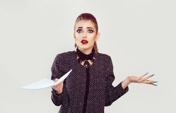 Woman looking frustrated at you holding papers contract nervously royalty free stock photos