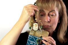 Woman Looking at Gift Royalty Free Stock Image