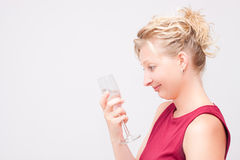 Woman looking at glass Stock Photos