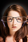 Woman looking at glasses Royalty Free Stock Images