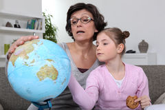 Woman looking at a globe Stock Photo