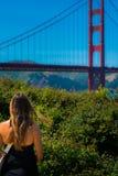Woman Looking at Golden Gate Bridge Stock Photo