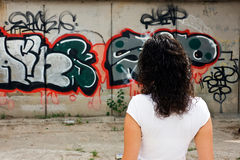 Woman looking graffiti. Samara. Russia Royalty Free Stock Photo