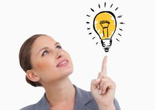 Woman looking at graphic light bulb Stock Photos