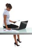 Woman looking at graphs Stock Photo
