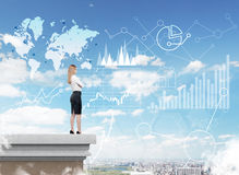 Woman looking at graphs and world map in the sky Royalty Free Stock Image