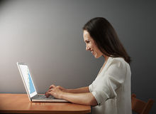 Woman looking at growing statistic Stock Image