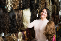 Woman looking at hair extensions Royalty Free Stock Image