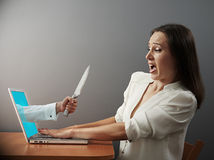 Woman looking at hand with knife Royalty Free Stock Photos