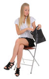 The woman looking in handbag. Royalty Free Stock Images