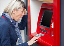 Woman looking at her bank account balance stock photography