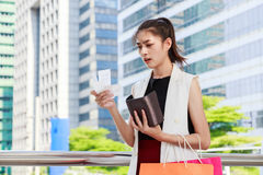 A woman looking at her bills in disbelief Royalty Free Stock Photos