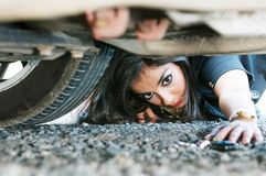 Woman looking for her car key Royalty Free Stock Photography