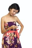 Woman Looking At Her Cellphone Stock Images