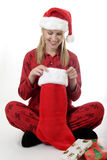Woman looking in her Christmas stocking Stock Photography