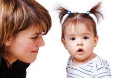 Woman looking at her daughter Stock Photos