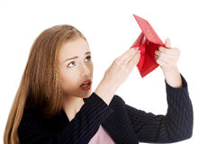 Woman is looking into her empty wallet. Stock Photography