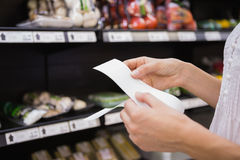 A woman looking at her grocery list Stock Photography