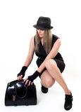 Woman looking into her handbag Stock Image