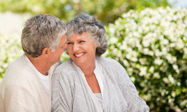 Woman looking at her husband in the garden Royalty Free Stock Photo