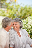 Woman looking at her husband in the garden Stock Photo