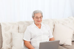 Woman looking at her laptop at home Royalty Free Stock Photo