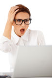 Woman looking at her laptop in horror Royalty Free Stock Photography